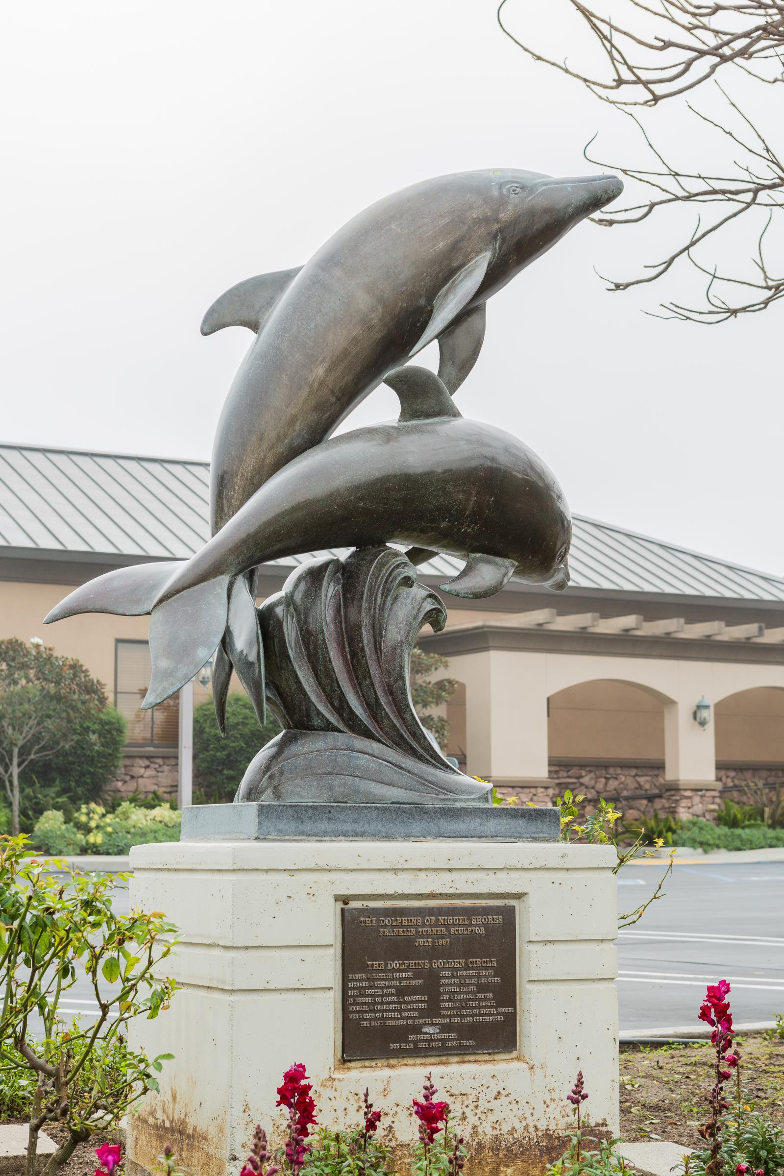 Sculpture of two dolphins- Niguel Shores
